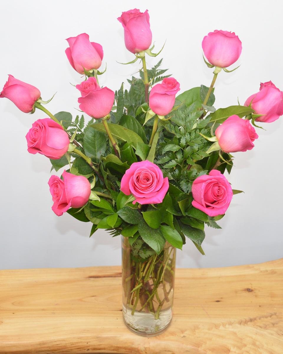 12 Pink Floyd Roses arranged in a Vase