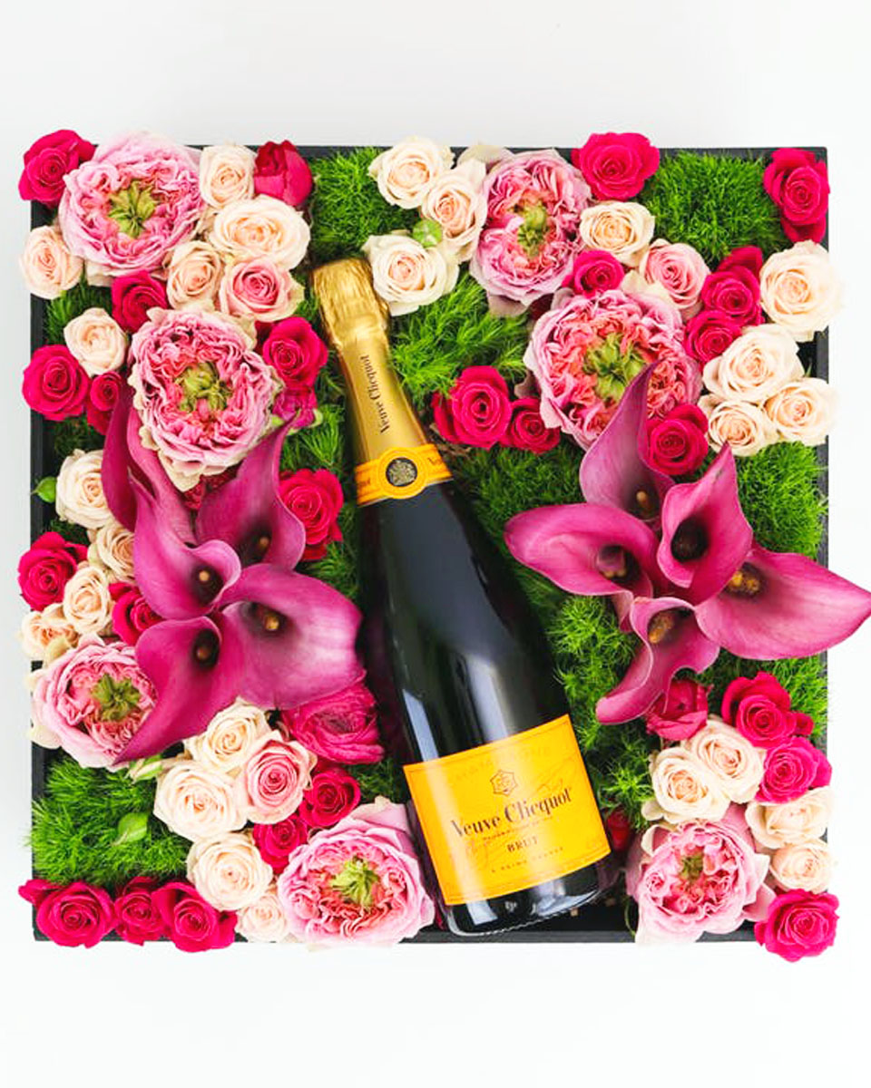With Veuve Clicquot Champagne