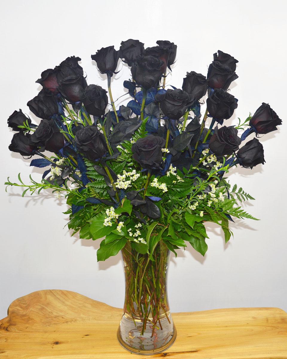 24 Black Magic Roses arranged in a vase