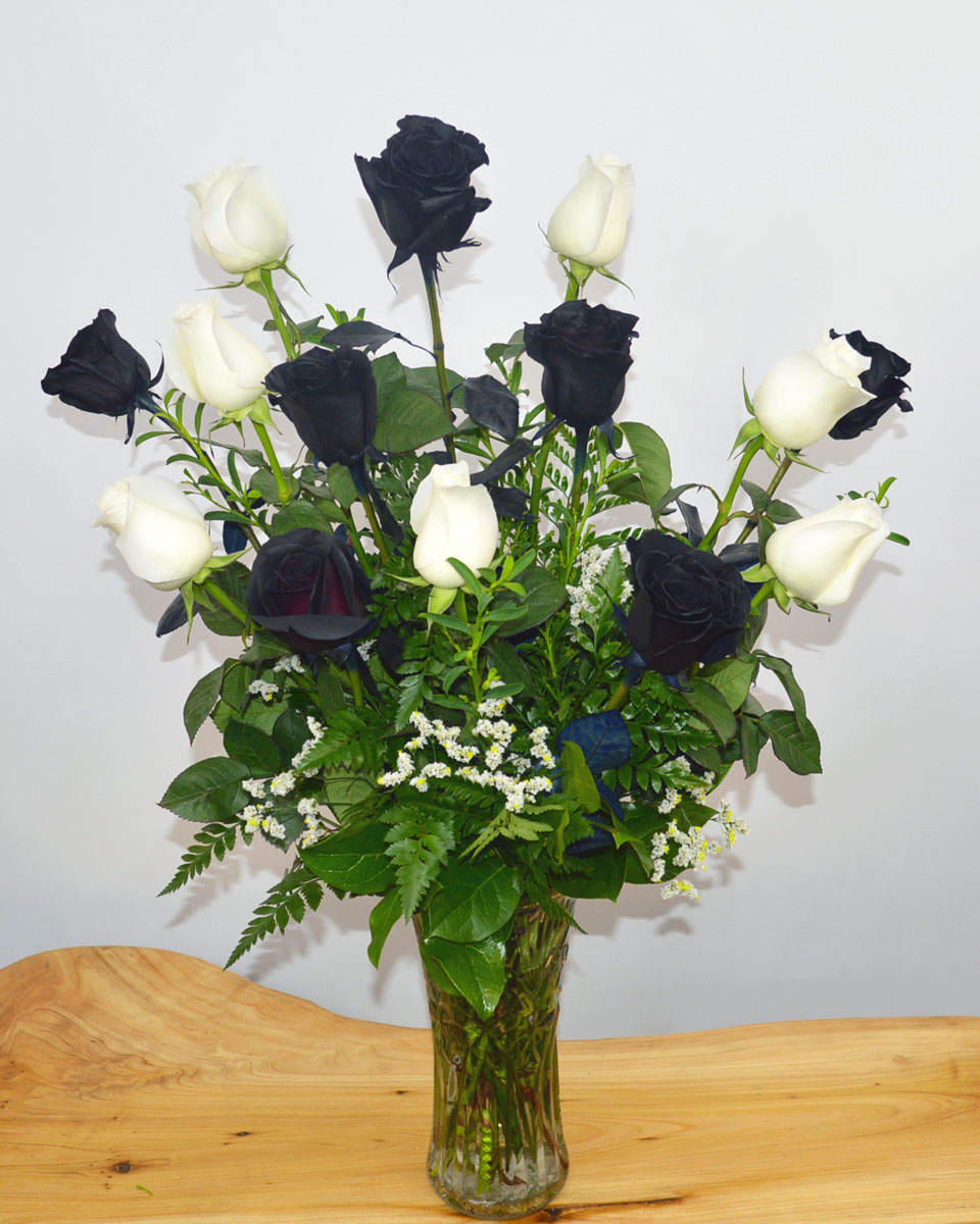 6 Black Roses and 6 White Roses Arrnaged in a vase