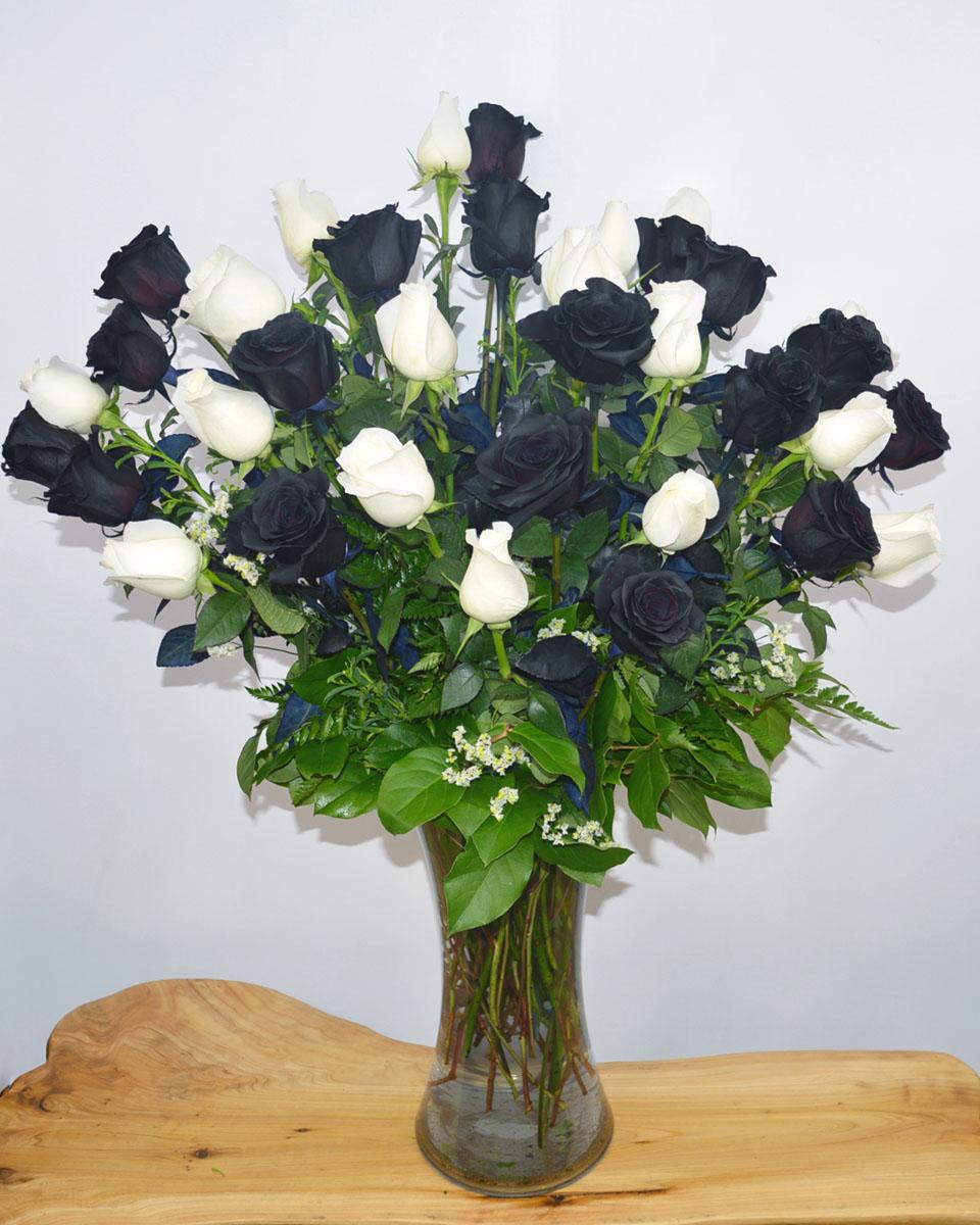 18 Black Magic Roses, 18 White Roses arranged in a vase