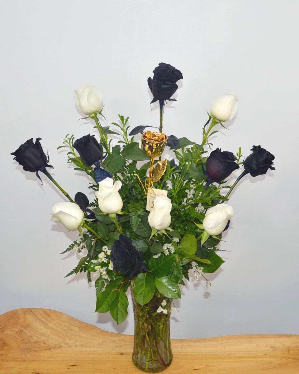 6 Black magic Roses, 6 White roses, and 1 Gold Dipped Rose Arrangement