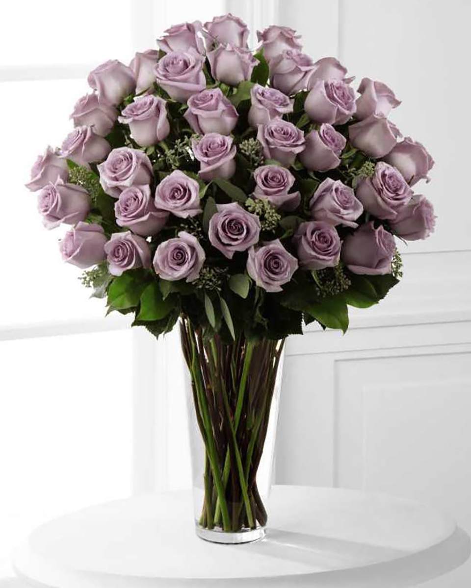 36 Purple Roses Arranged in a Vase